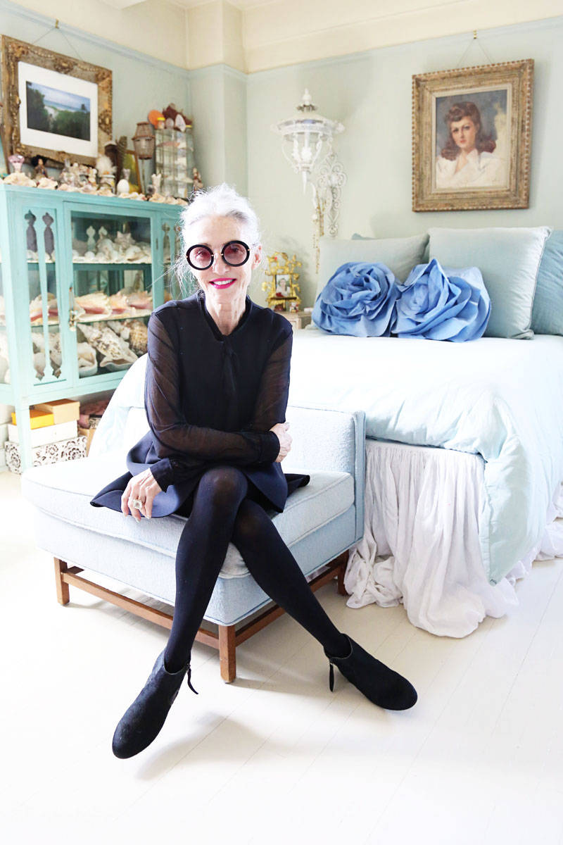 Rodin in her bedroom wearing glasses (throughout) by Miu Miu, top by Nina Ricci, dress by Tamara Jaric, and boots by Joe Fresh.